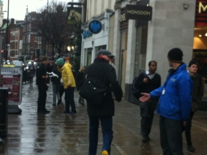 The chap from Wagamama is offering free tasters and has a queue. The street fundraiser is having less interest